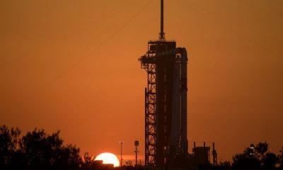 Sunrise behind the Demo-2 mission waiting on the launch pad.