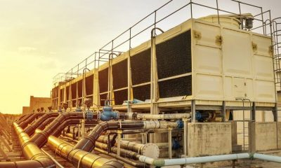 Large cooling systems on top of a data centre against a sunset background.