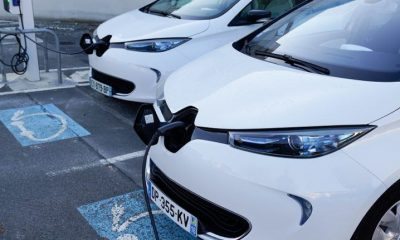 Two Renault Zoe EVs at a charging station in France.