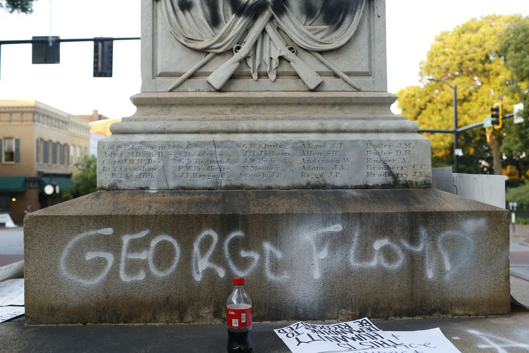 In this Sunday, May 31, 2020 photo, protesters vandalize the downtown Athens Confederate War Memorial after the main protest ended in downtown Athens, Ga. The protest was organized to demonstrate against the death of George Floyd, who died in police custody in Minneapolis on May 25, sparking demonstrations and riots around the country.