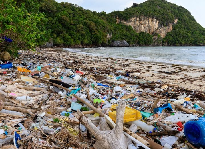 Paradise beach in Thailand covered in ocean plastic.