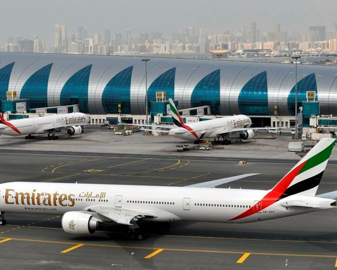 In this March 22, 2017, file photo, an Emirates plane taxis to a gate at Dubai International Airport in Dubai, United Arab Emirates. The Middle East's biggest carrier, Emirates, declared on Sunday, May 10, 2020, higher profits of $288 million over the past year even as revenue declined due to flight suspensions sparked by the coronavirus, offering a glimpse of the financial toll now facing airlines around the world.