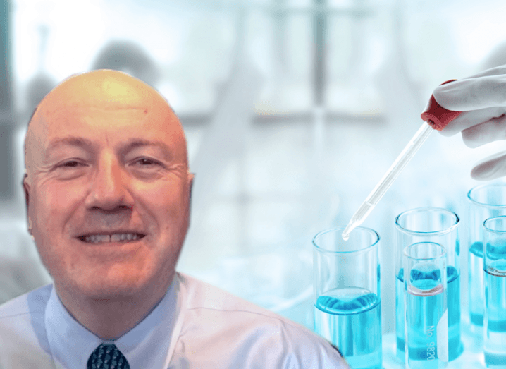Mark Ferguson smiling, with an edited background of a science lab behind him.