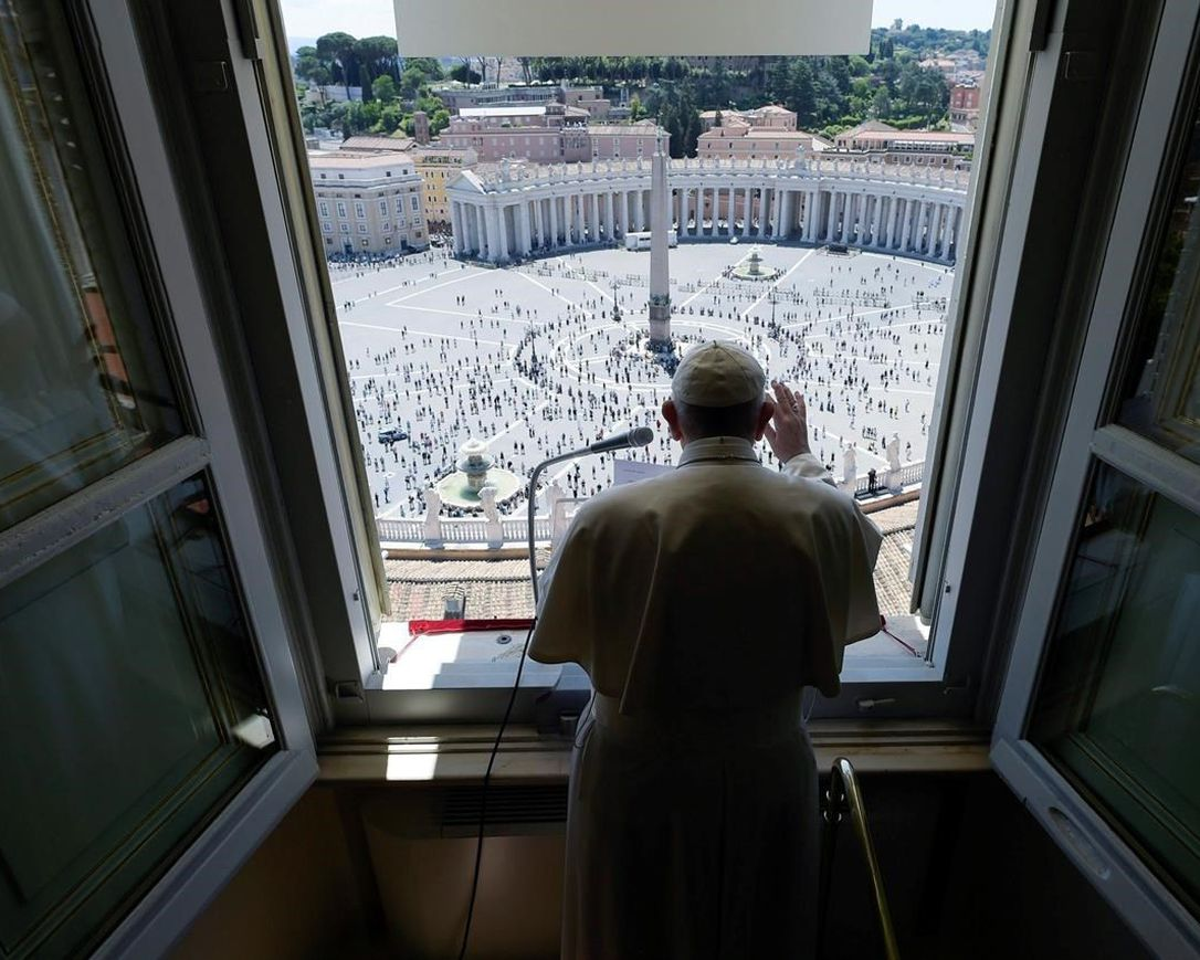Pope Francis delivers his blessing from his studio window overlooking St. Peter's Square at the Vatican, Sunday, May 31, 2020. Francis celebrated a Pentecost Mass in St. Peter's Basilica on Sunday, albeit without members of the public in attendance. He will then went to his studio window to recite his blessing at noon to the crowds below. The Vatican says police will ensure the faithful gathered in the piazza keep an appropriate distance apart.