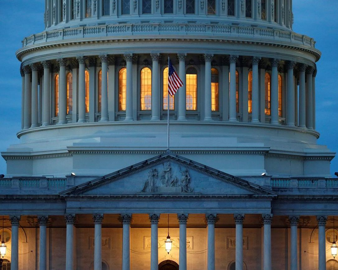 In this May 3, 2020, file photo, light shines from inside the U.S. Capitol dome at dusk on Capitol Hill in Washington.