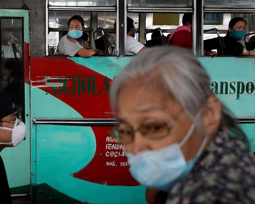 People ride a bus during the first day of a more relaxed lockdown that was placed to prevent the spread of the new coronavirus in Manila, Philippines on Monday, June 1, 2020. Traffic jams and crowds of commuters are back in the Philippine capital, which shifted to a more relaxed quarantine with limited public transport in a high-stakes gamble to slowly reopen the economy while fighting the coronavirus outbreak.