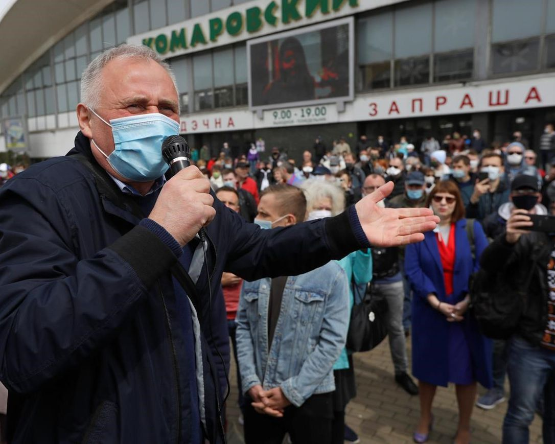 In this file photo taken on Sunday, May 24, 2020, an opposition activist Nikolai Statkevich, wearing a face mask to protect against coronavirus, gestures as he speaks to people gathered to sign up and support potential presidential candidates in the upcoming presidential elections in Minsk, Belarus. On Sunday, Nikolai Statkevich, one of Belarus' most prominent opposition figures, was detained while heading for a protest in Minsk.