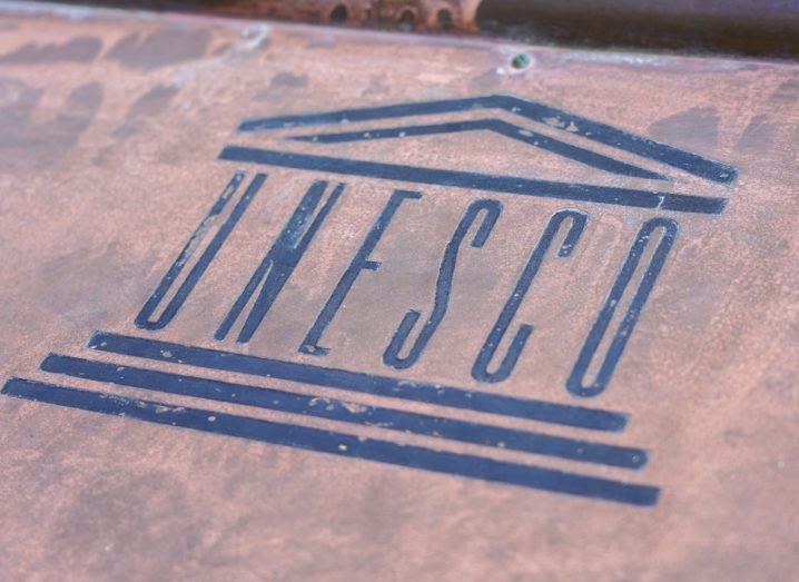 UNESCO logo stenciled on to a steel surface.