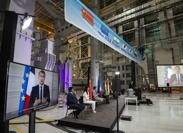 Panel at the launch of the ITER's assembly phase with Emmanuel Macron on large TV screens.