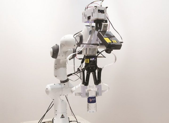 The robot arm built with artificial skin against a white background.