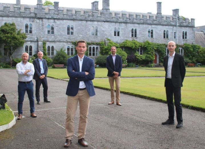 A group of researchers from SeqBiome are standing in the grounds of University College Cork and smiling into the camera.