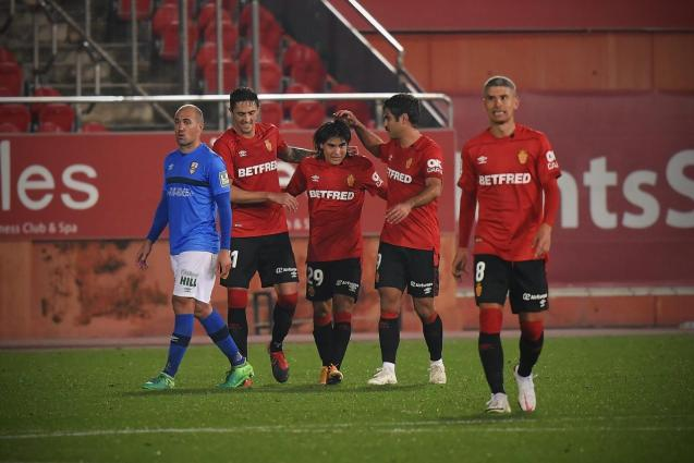 Luka Romero (no. 29) is congratulated after scoring his first professional goal for Real Mallorca