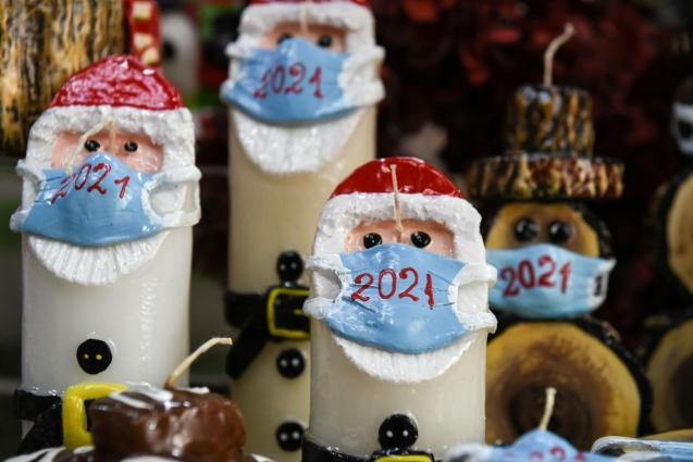Christmas candles depicting Santa Claus with mask displayed in Thessaloniki