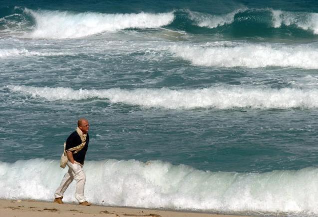 Man walking by the sea