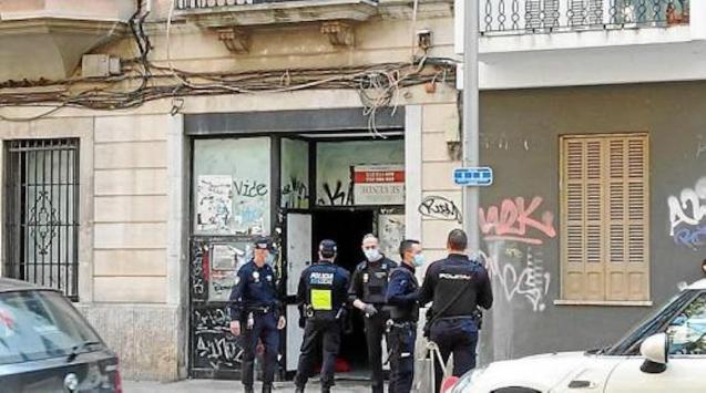 Police at Palma squat.