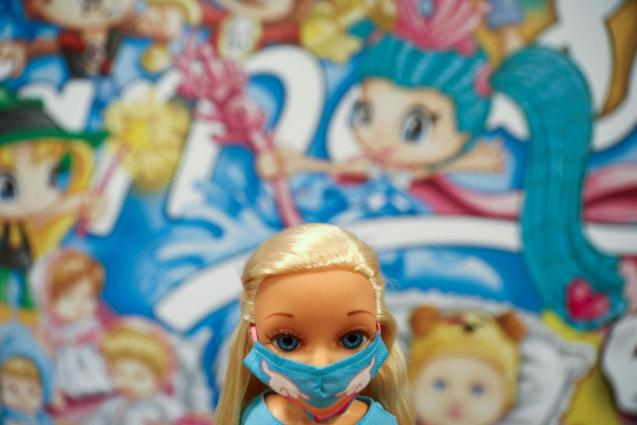 A Nancy doll, one of Spain's most beloved toys, is seen wearing a protective face mask at the headquarters of Spanish toy maker Famosa, in Madrid