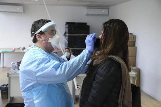 Healthcare Professional performing PCR test, Palma.