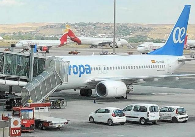 Air Europa & Iberia planes at the airport.